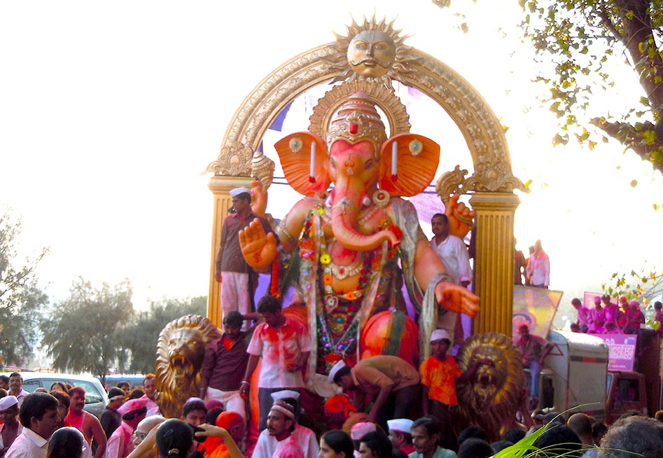 The effigy of Ganesh being led to the sea.