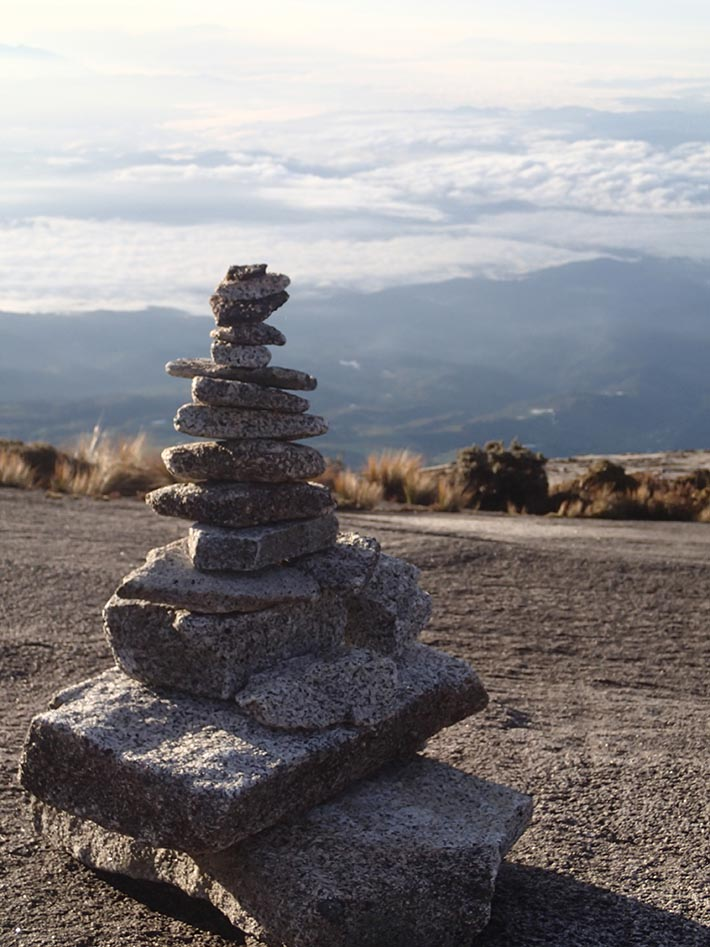 Delicately laid rock cairn on the summit trail.