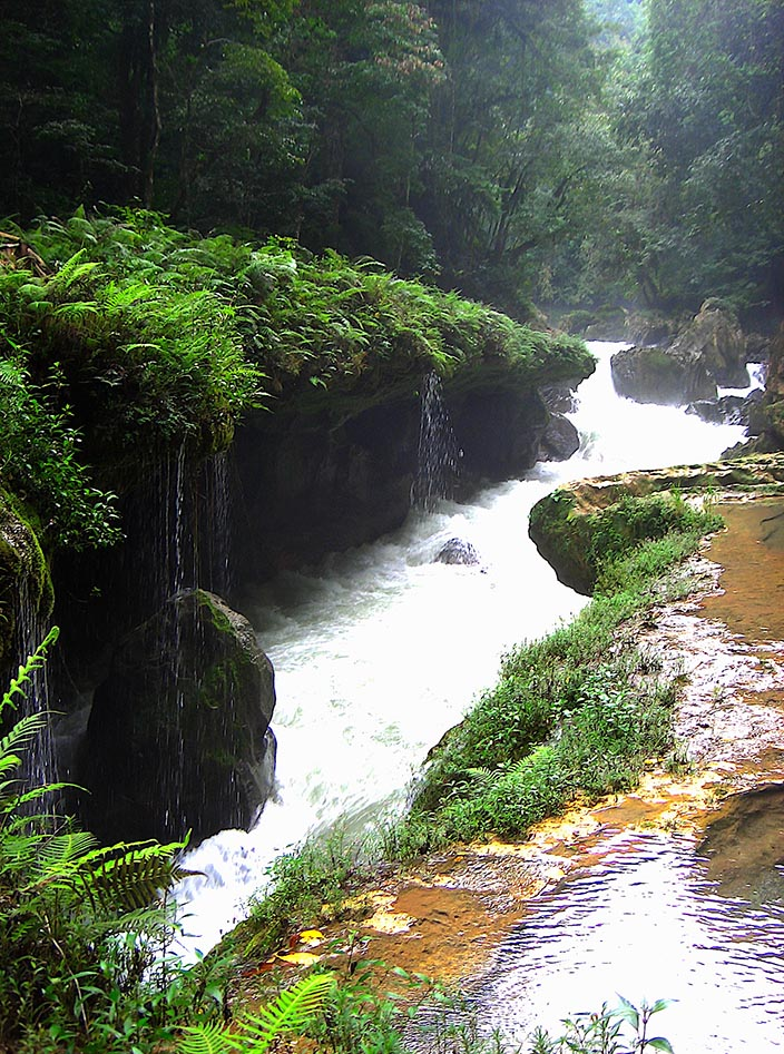 The rushing river through the limestone of Semuc Champey, Guatemala.