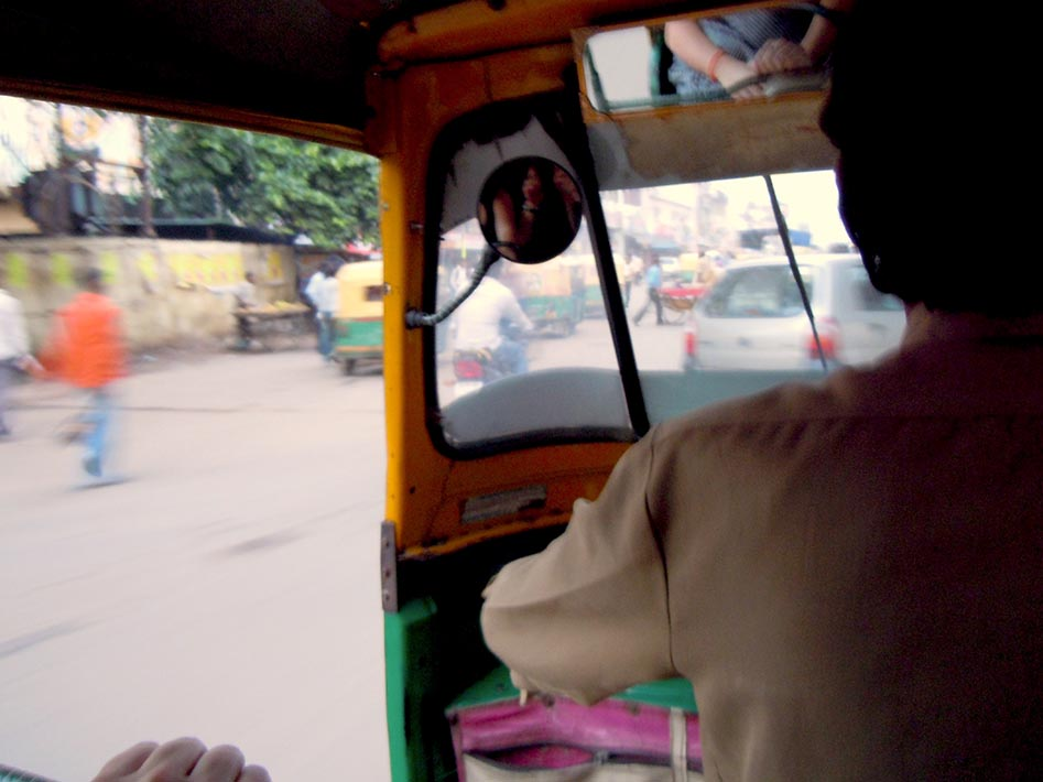 Racing through the streets of Agra aboard a Tuk Tuk